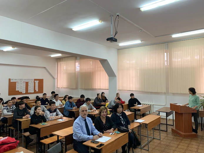 Listeners of the lecture that conducts Guldana Ispambetova. In front of the participants are project partners: Angela Repanovich (Transilvania University of Brașov), Monolis Koukourakis (University of Crete), Gainel Ussatayeva (al-Farabi KazNU) and other listeners from University